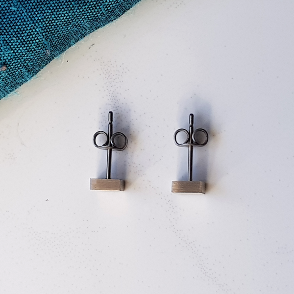 geometric square titanium stud earrings top view