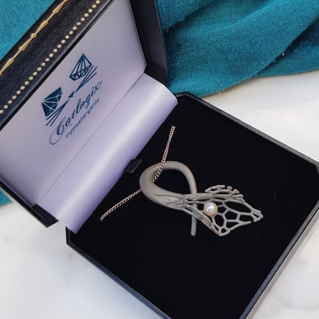 3d printed titanium pearl jewelry in box