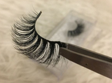 Our eyelash tweezers holding up the Passion eyelashes, great for any makeup look