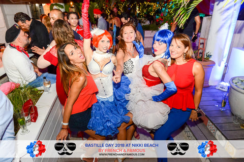 Guests and performers dancing at the Bastille Day event organized by French & Famous