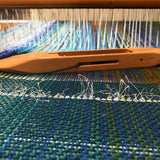 A Tui wrap on the loom while being handwoven from kiwi yarns by Wrapt in New Zealand as an ideal VIP gift