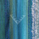 Taniko pattern detail on a Tui wrap handwoven from kiwi yarns by Wrapt in New Zealand as an ideal VIP gift
