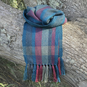 Silky soft handwoven alpaca scarf featuring a sophisticated twill diamond pattern in blueberry tones of kingfisher blue, grey and raspberry.