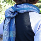 Silky soft handwoven alpaca scarf featuring a sophisticated twill diamond pattern in denim tones of kingfisher blue, navy blue, charcoal and silver.