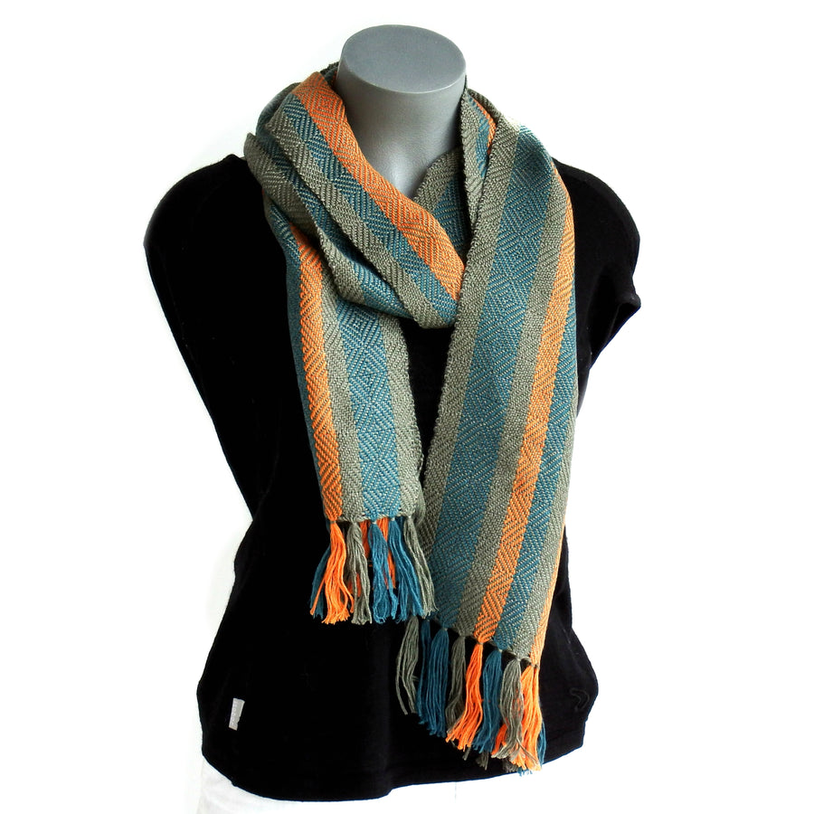 Silky soft handwoven alpaca scarf featuring a sophisticated twill diamond pattern in striking contemporary tones of kingfisher blue, orange and grey.