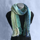 Thick and chunky handwoven scarves, with colours inspired by soft pink seashells, black and white shellfish, and the greens and blues of the ocean.