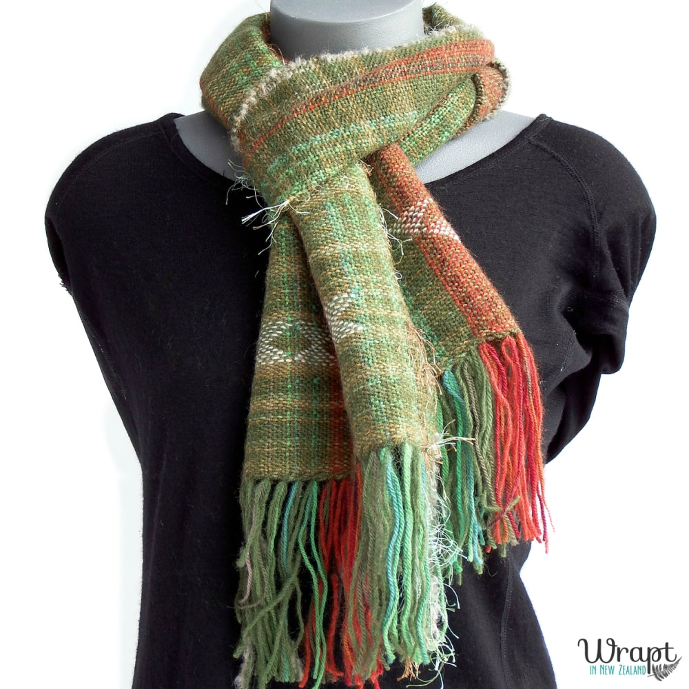 Warm scarf handwoven in New Zealand in green, brown and orange, inspired by the native Kea bird