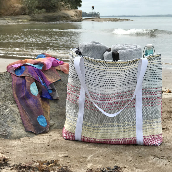 The recycled plastic tote bag is ideal for the beach
