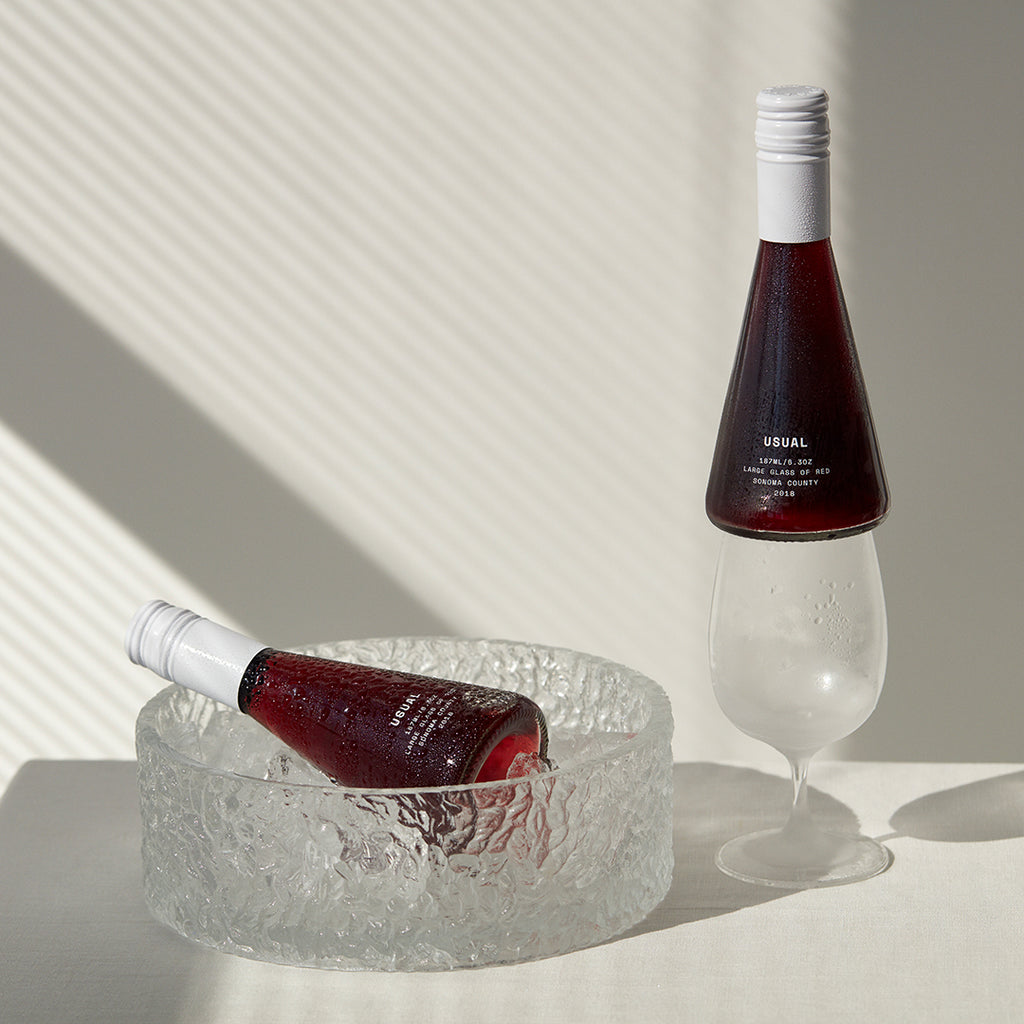 red wine on a glass and ice bucket
