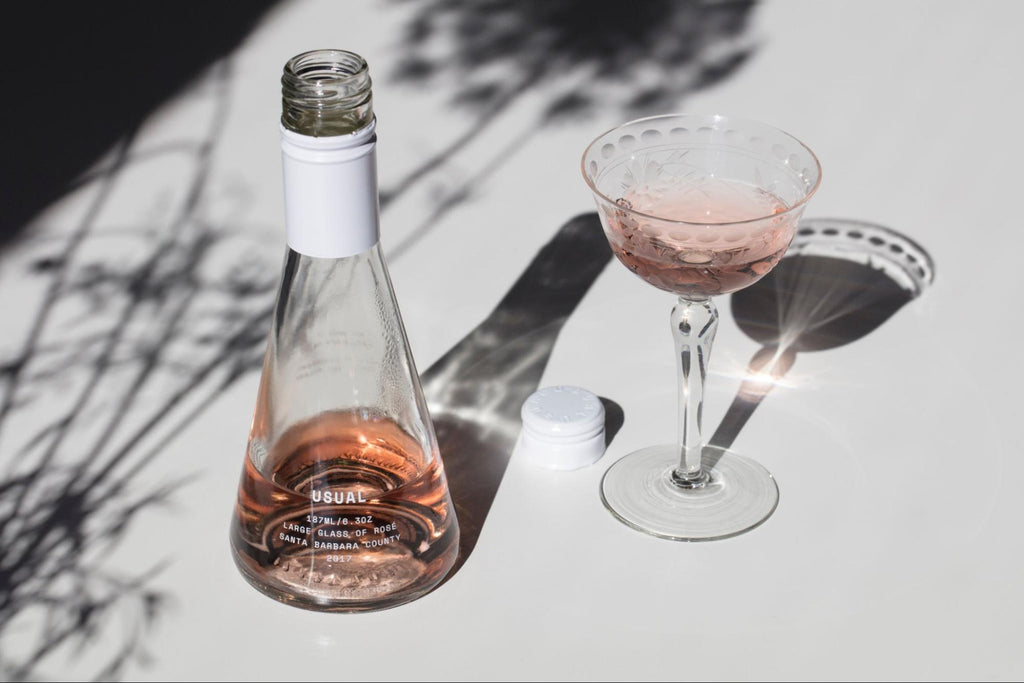 white wine glasses: Usual Wines bottle and a margarita glass on the table
