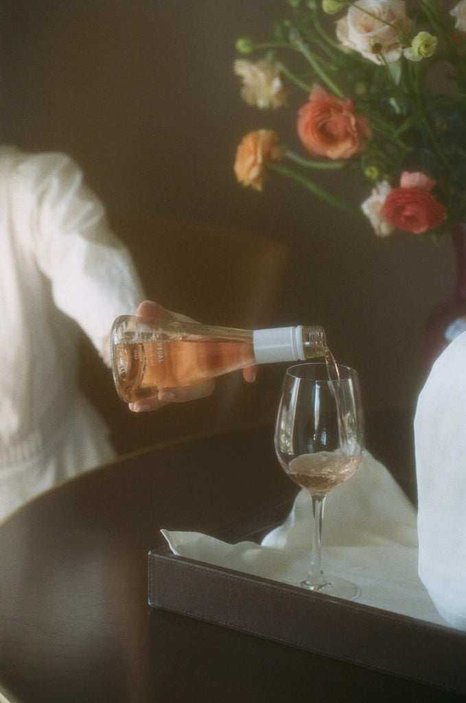 Cooking wine: Person pours Usual Wines Rose into glass