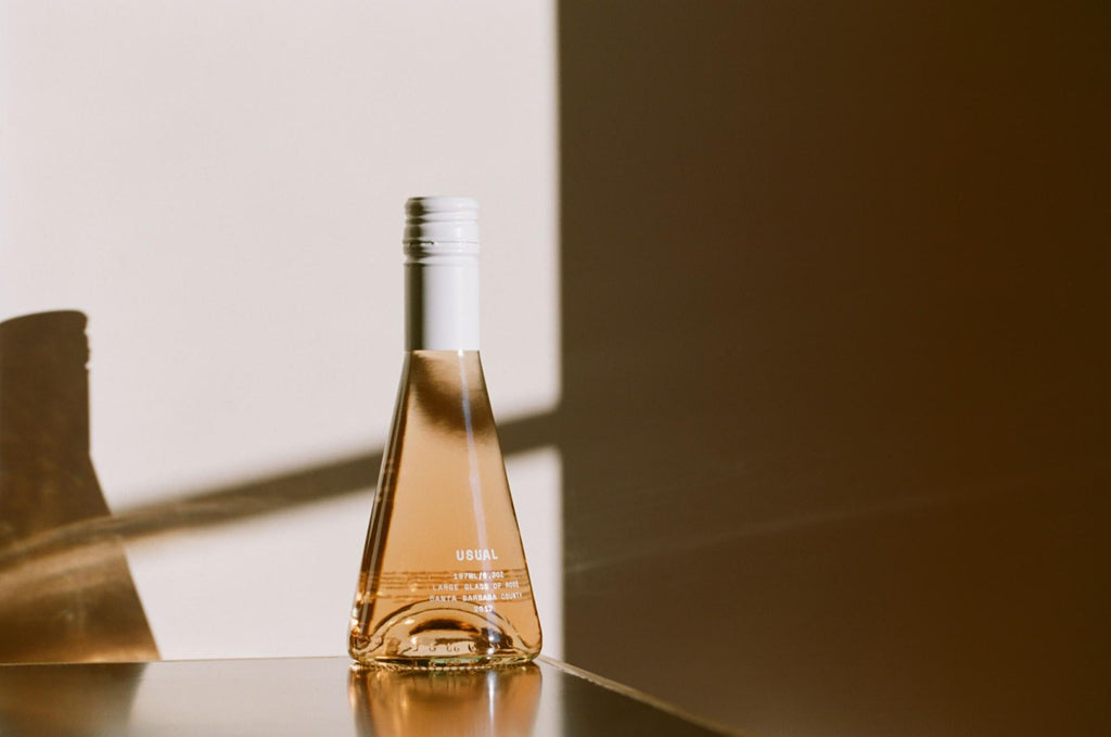 what are sulfites: Usual Wines bottle on a table