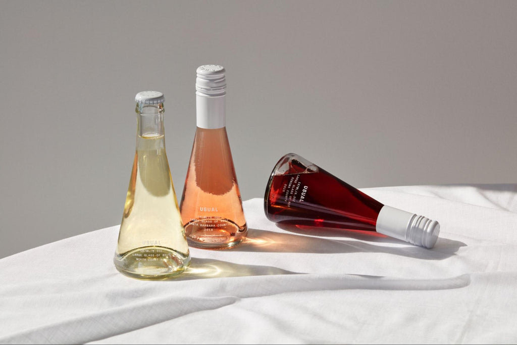 individual bottles of Brut, Rosé, and Red wine from Usual Wines