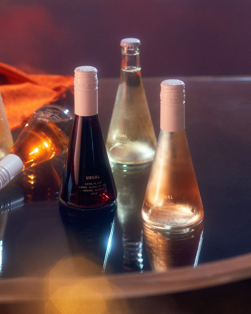 sugar in wine: four Usual Wines bottles on a table