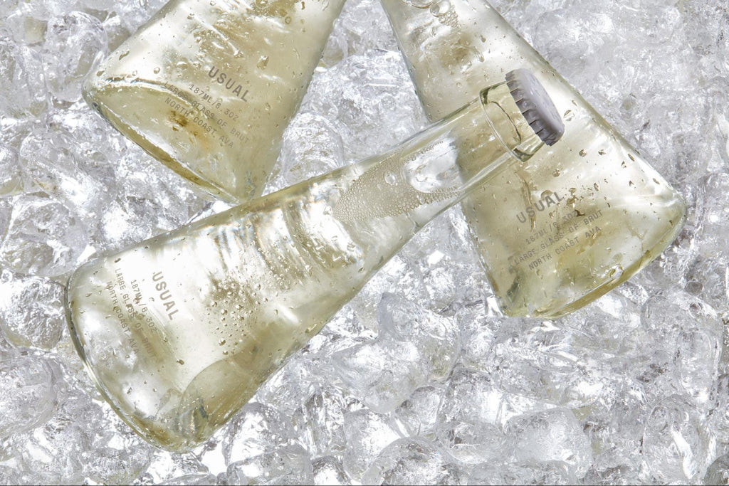 Chenin Blanc wine: Three Usual Wines bottles on top of ice cubes