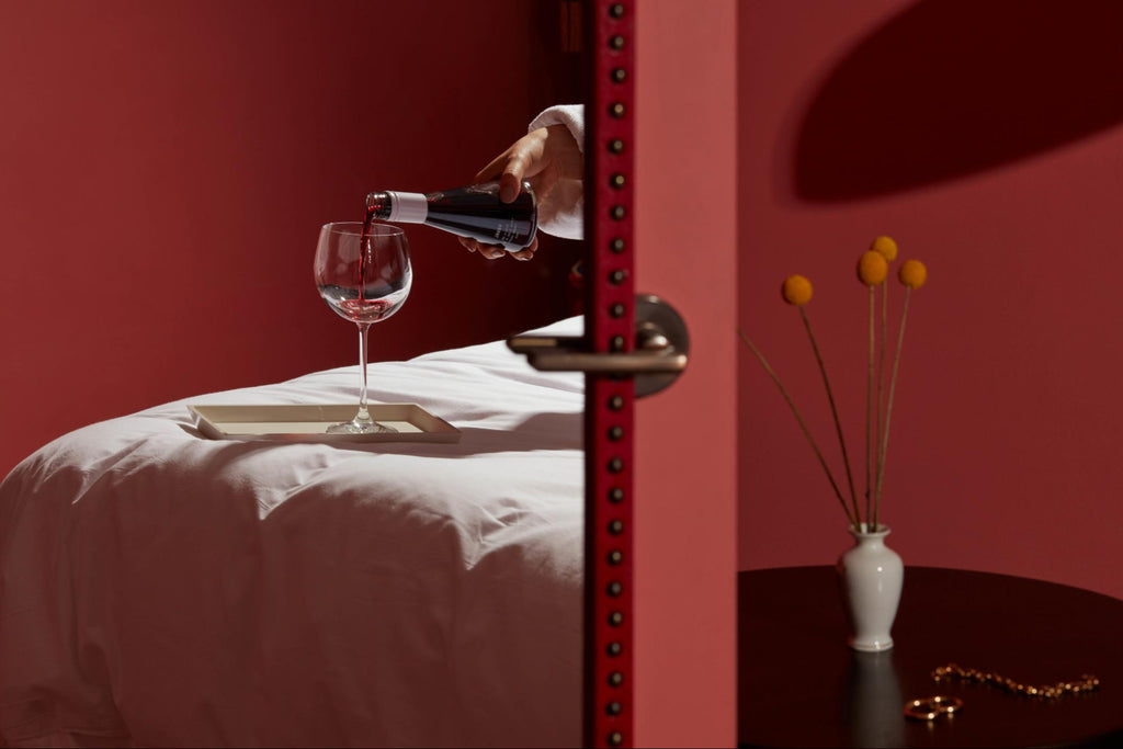 red wine sweetness chart: Usual Wines being poured into a wine glass in bed