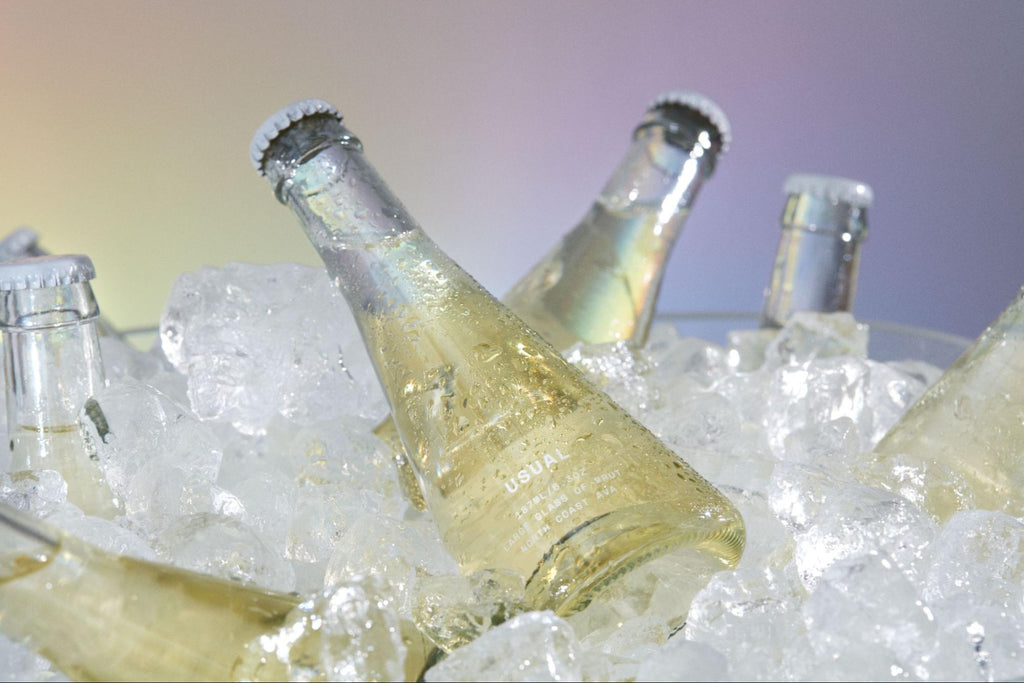 Muscat wine: several bottles of Brut from Usual Wines in a bucket filled with ice