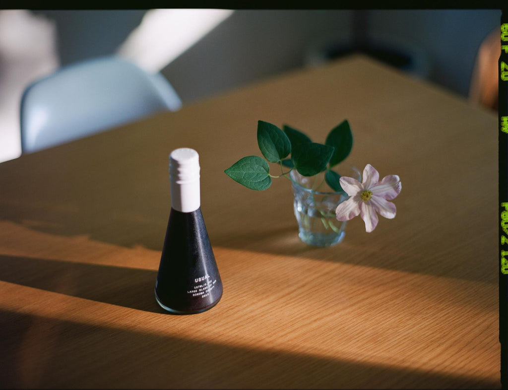 Moscato wine on a table with flowe on a small vase