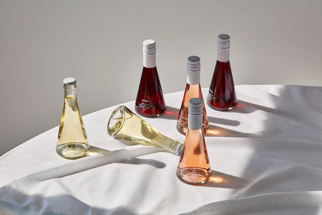clean crafted wine: six Usual Wines bottles on a table