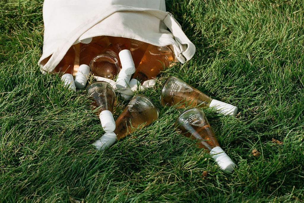 Bottles of Usual Wines rose on the grass