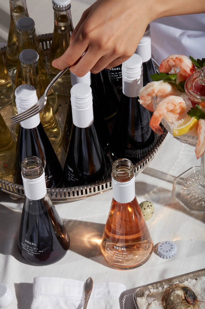 Wine legs: A table spread with Usual Wines and shrimp cocktail