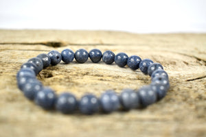 Handmade stretchable bracelet from 10mm Blue coral beads.