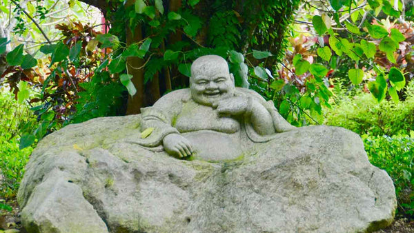 Understanding the Symbols of Laughing Buddha for Better Feng Shui