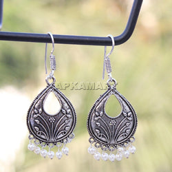 APKAMART White Tribal Dangler Earrings