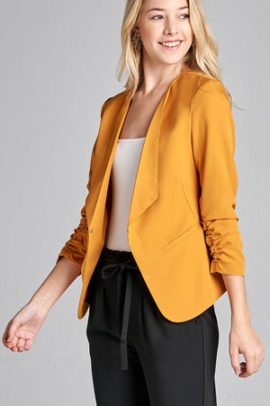 Material: Polyester 3% Spandex Sleeves: 3/4 shirring sleeve Closure Type: None, open front Fit Type: Regular Open Front Woven Jacket, mustard color