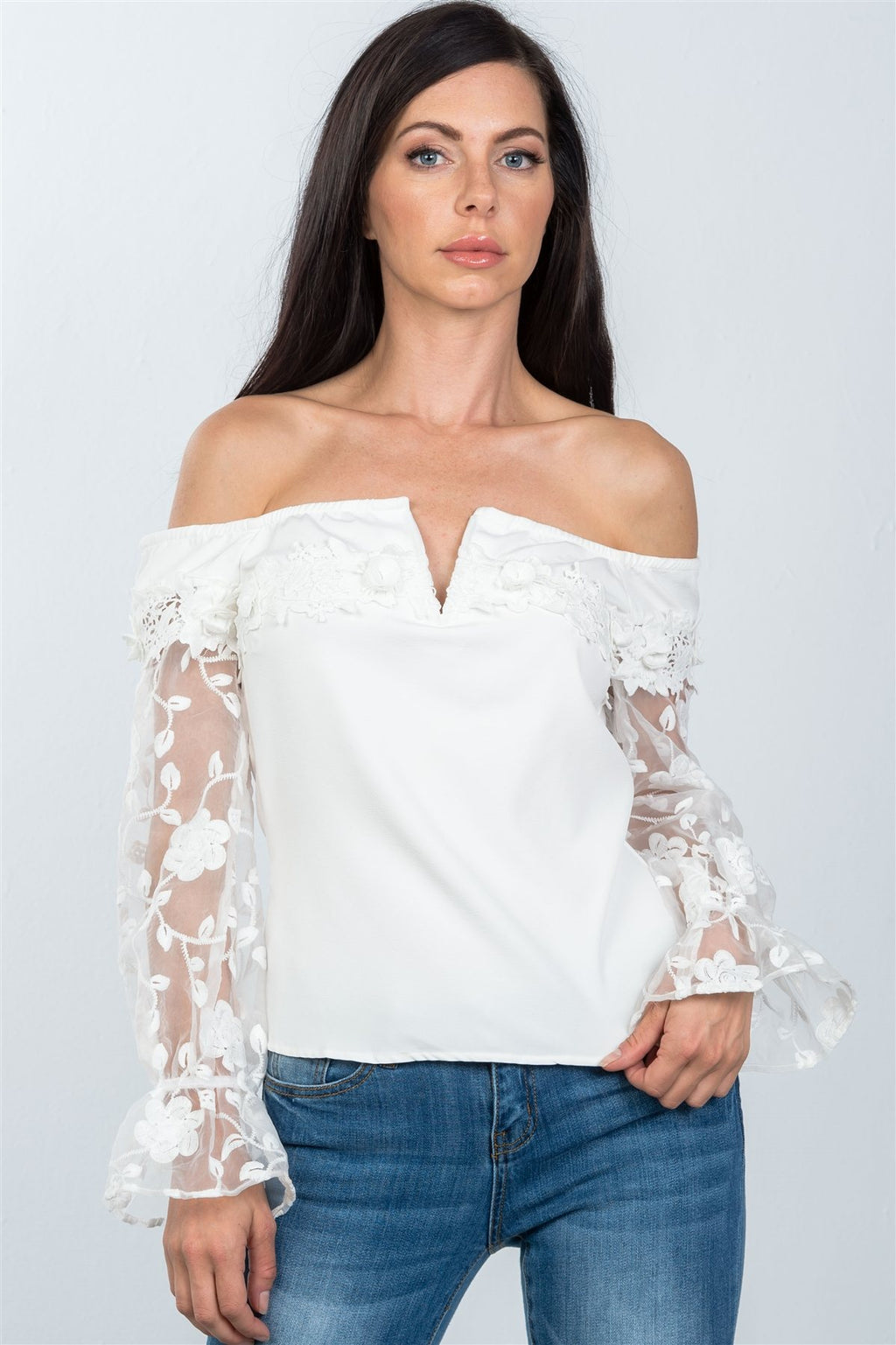Off the Shoulder Floral Applique Top Material:97% Polyester 3% Spandex, Slightly sheer. Sleeve Length: Long Neckline: Off the shoulder, V-Wire neckline Closure Type: Back zipper and hook-and-eye closure Details: Floral textured sleeves, bell sleeves, off white color