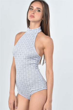 Material: 68% Cotton 30% Nylon 2% Spandex Bodysuit features: High neckline, mesh hole pattern, hook-and-eye bottom closure, sleeveless, open back. Skirt: high waisted, elastic waistband, mesh hole pattern allover, midi length. Mesh Hole bodysuit and Midi Skirt , lilac color