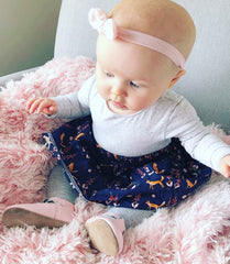 Little angel wearing our Navy Fox skirt