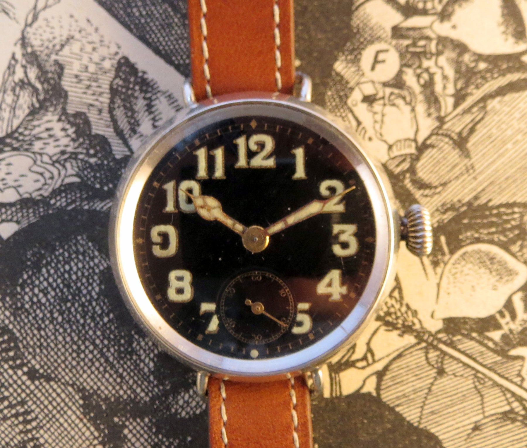1918 Hallmarked silver trench watch with black dial, luminous hands and numerals.