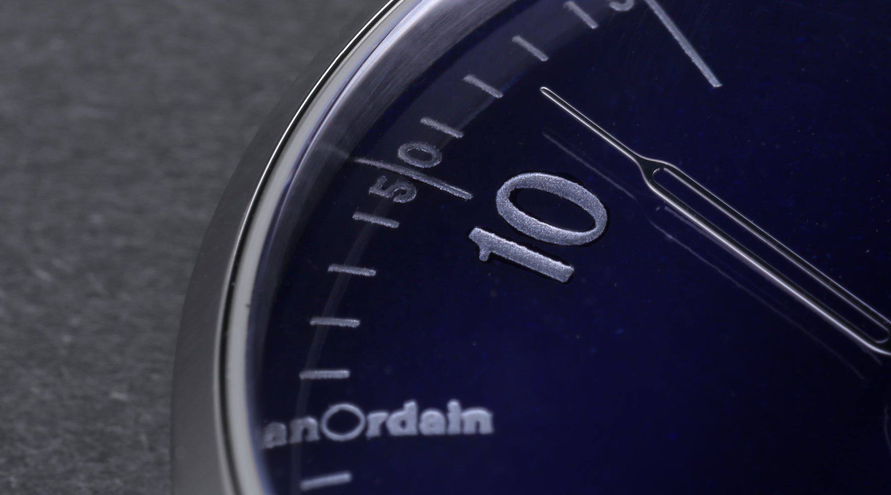 A close-up view of the translucent blue dial