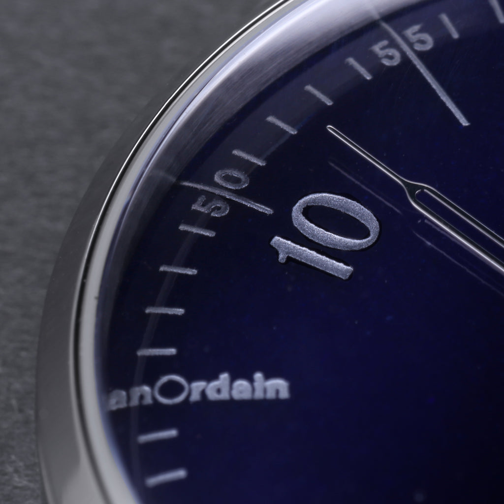 Detail of numerals on translucent blue enamel dial