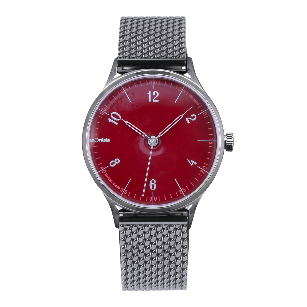 anOrdain Model 1 with post office red dial and Staib Milanese mesh strap