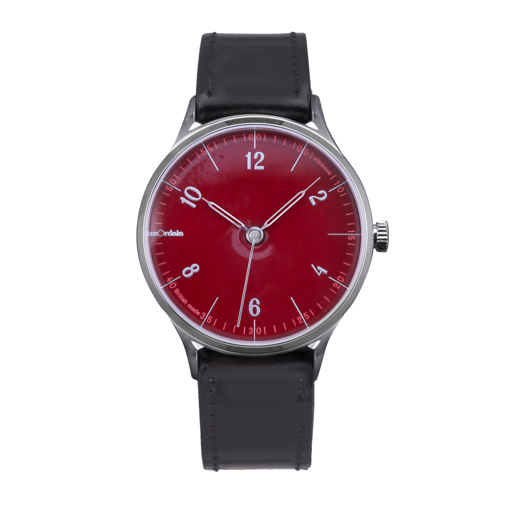 anOrdain Model 1 with post office red dial and black shell cordovan strap