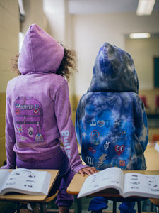 Two children wearing tie-dye hoodies