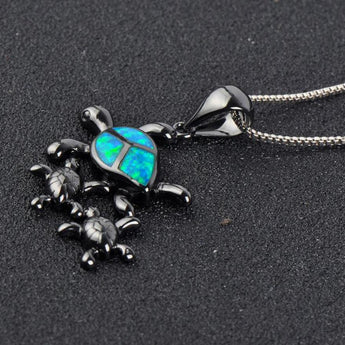 Aquastone™ - Blue and White Fire Opal Ohana Sea Turtle Black Gold Necklace