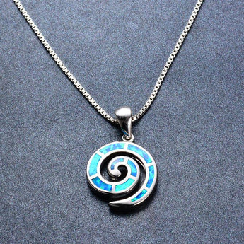 Aquastone™ - Blue Fire Opal Nautilus Seashell Necklace