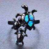 Aquastone™ - Blue Fire Opal Ohana Sea Turtle Black Gold Ring
