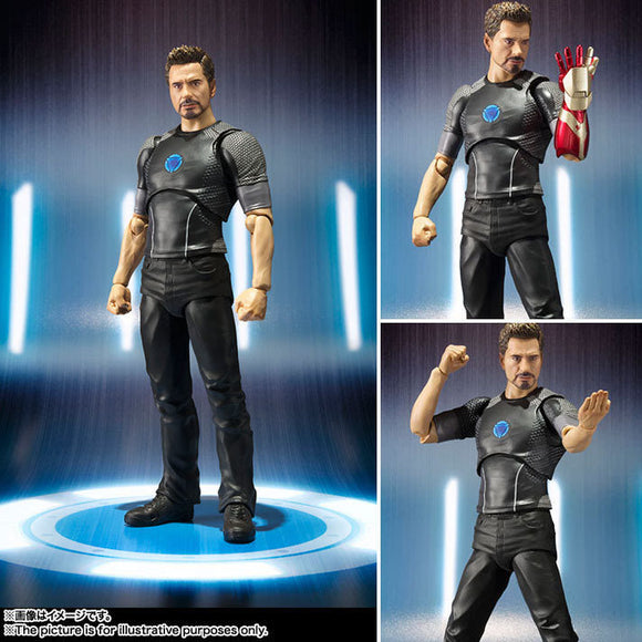 Tony Stark putting on Ironman suit action figure