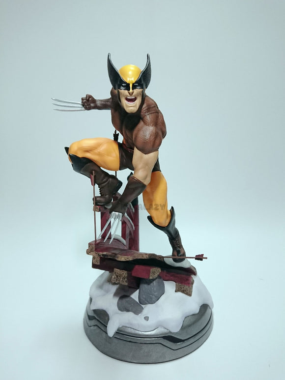 Wolverine Figure with Logan Head statue