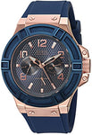 GUESS  Rigor Iconic Blue Stain Resistant Silicone Watch with Rose Gold-Tone Day + Date. Color: Blue (Model: U0247G3): guess: Gateway