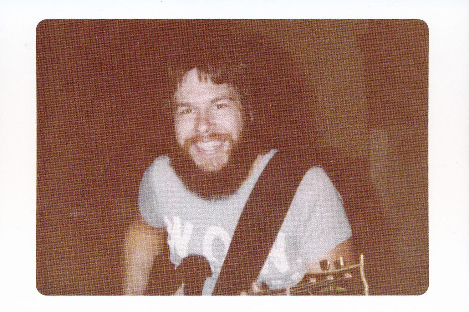 Front of postcard liner note for AGS-7001. Photograph of Mike Lundy at The Rhythm Of Life recording sessions in 1980.