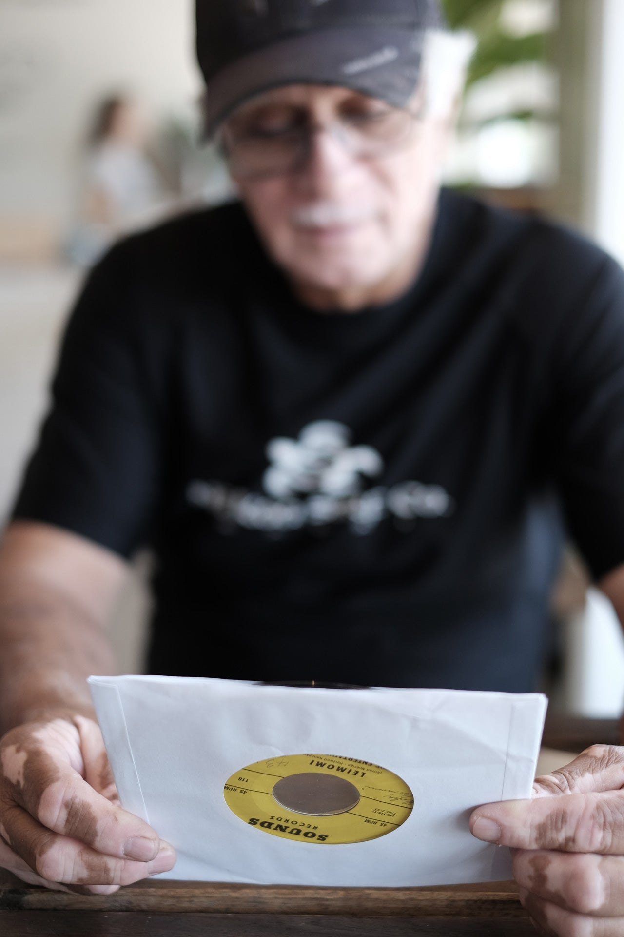 "Al Nobriga with a copy of ""Leimomi"" by The Entertainers Five. Nobriga wrote the song for his daughter."