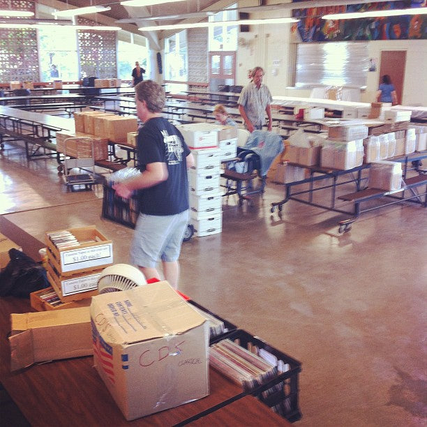 Sellers start hauling vinyl into the cafeteria.