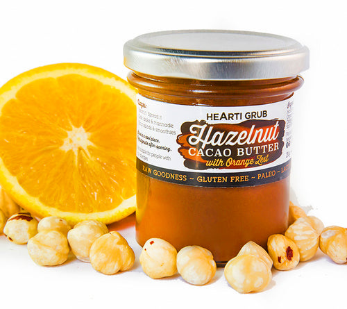 CACAO HAZELNUT BUTTER by HEARTIGRUB. RAW CACAO, TURKISH HAZELNUTS, HINT OF HONEY. THE BETTER HAZELNUT BUTTER WITH ORANGE ZEST By HEARTIGRUB. Made in Dubai, UAE. Nut Butter s and Spreads