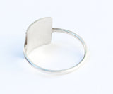 back of silver square ring