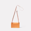 Mini Lock Boundary Leather Crossbody Lock Bag in Apricot Back